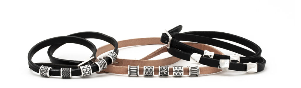 silver beads on leather straps designed for Munio