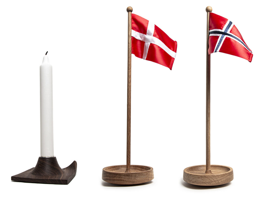 A tableflag and a chamber candle stick both made from wood