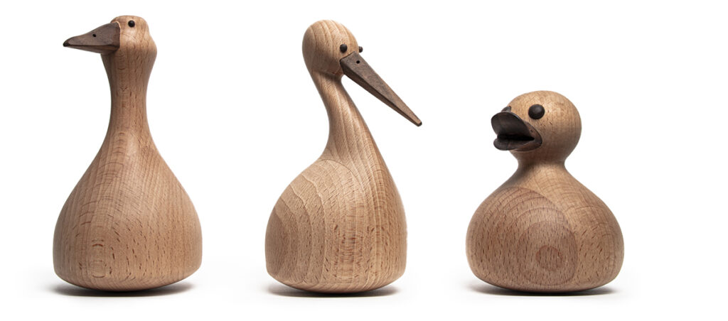 wooden tumbler figures of a goose, a duckling and a stork